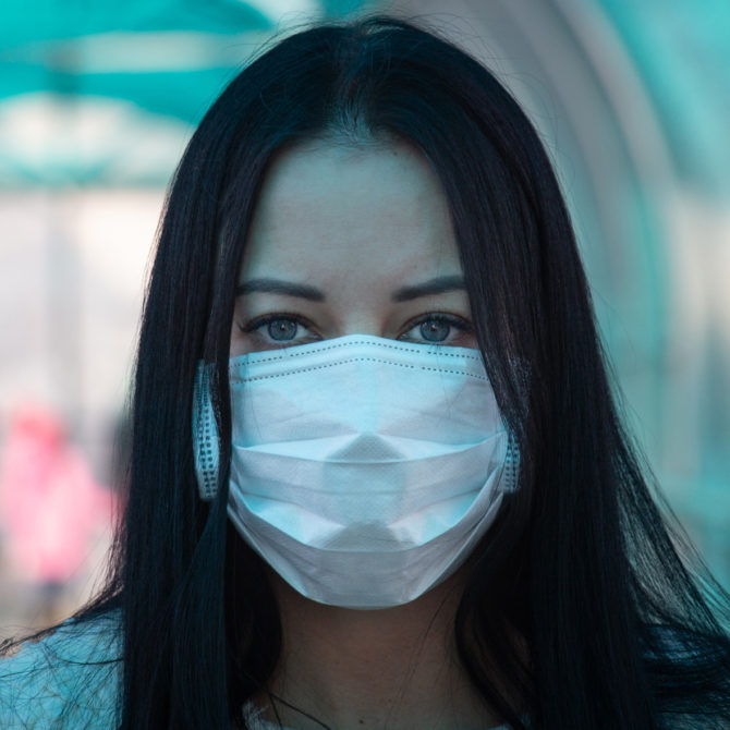Young woman wearing COVID-19 mask